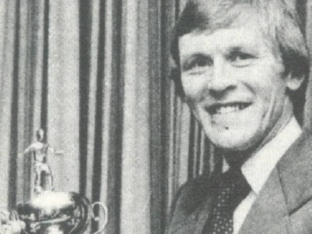 john roberts with trophy