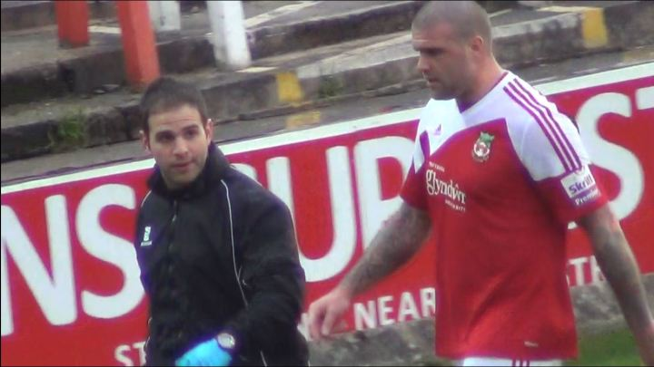 Mark Creighton leaves the pitch for the last time after breaking down against Gresley.